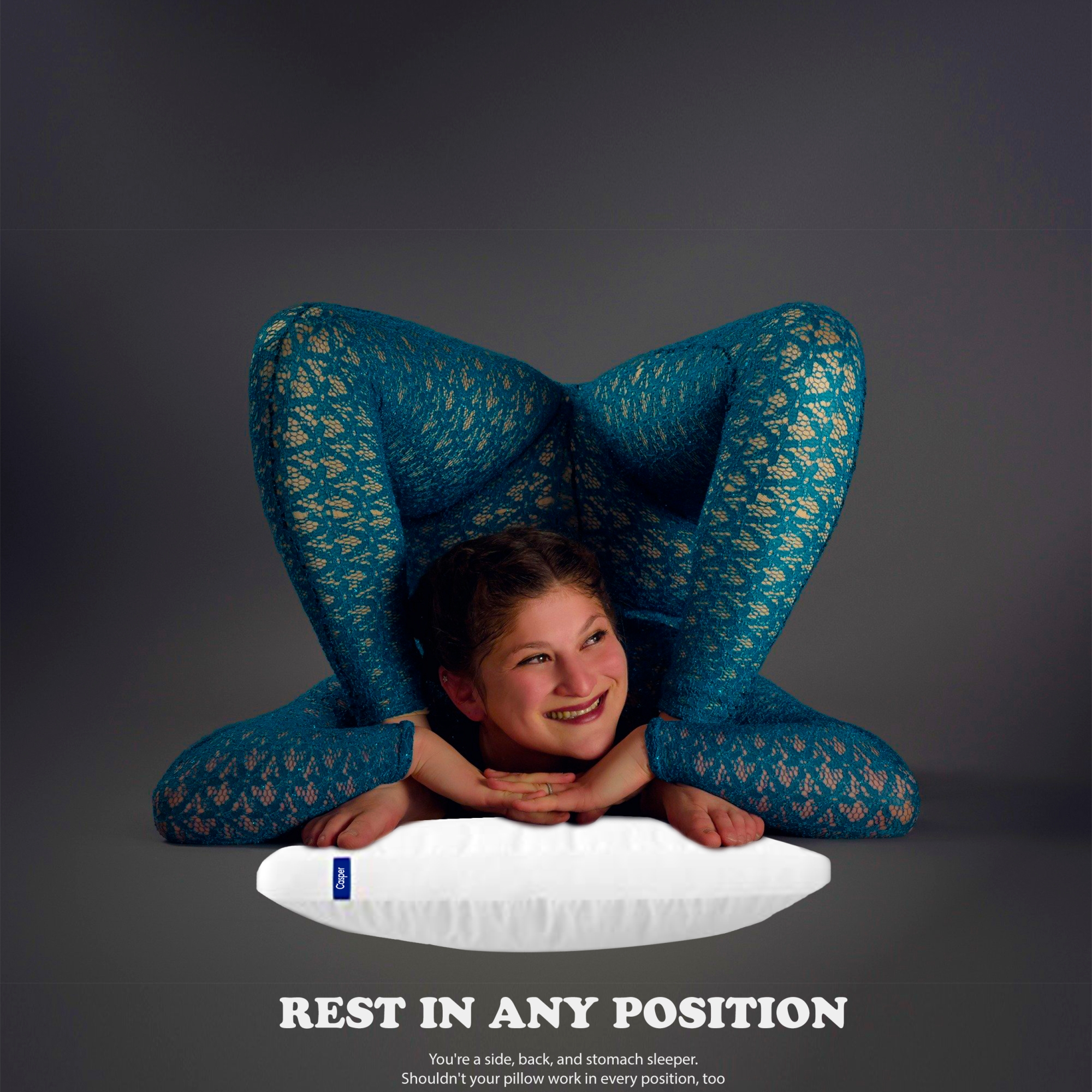 Contortionist girl resting on a pillow